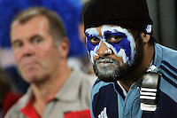 A Blues fan watches the action during the Super 15 rugby match between the Blues and the Sharks at Eden Park, Auckland, New Zealand on Friday, 13 April 2012. Photo: Dave Lintott / lintottphoto.co.nz