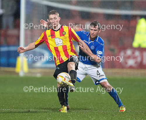 Partick Thistle v St Johnstone....21.01.14   SPFL<br /> Chris Erskine and Paddy Cregg<br /> Picture by Graeme Hart.<br /> Copyright Perthshire Picture Agency<br /> Tel: 01738 623350  Mobile: 07990 594431