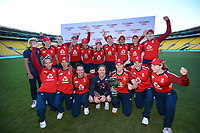 The England team celebrates winning the international women's T20 cricket series between the New Zealand White Ferns and England at Sky Stadium in Wellington, New Zealand on Sunday, 7 March 2021. Photo: Dave Lintott / lintottphoto.co.nz