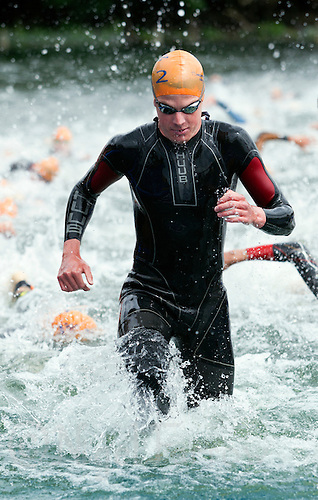 31 MAY 2014 - LONDON, GBR - Jonathan Brownlee (GBR) (ENG) of Great Britain and England leaves the water at the end of the swim during the men's 2014 ITU World Triathlon Series round in Hyde Park, London, Great Britain (PHOTO COPYRIGHT © 2014 NIGEL FARROW, ALL RIGHTS RESERVED)