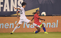 CHARLOTTE, NC - OCTOBER 03: Crystal Dunn #19 of the United States hits a ball past KIM Hyeri #20 of Korea Republic during a game between the USA and Korea Republic at Bank of American Stadium, on October 03, 2019 in Charlotte, NC.