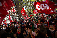 """Rome, Italy. 10th October, 2021. Today, thousands of people gathered outside the CGIL (CGIL Confederazione Generale Italiana del Lavoro, Italian General Confederation of Labour, Italian biggest Trade Union) HQ in Corso d'Italia in Rome to attend the Trade Union emergency General Assembly called after the vile attack perpetrated yesterday against the CGIL HQ by the fascist organization forza nuova (for a previous demo: 2.), members of no vax, no pass, no green pass, football supporters, conspiracy theorists, far-right extremists, Covid-19 deniers (negazionisti). The General Secretary of the CGIL, Maurizio Landini, in his today speech stated that what happened yesterday was a """"fascist and squad action"""" against the Workers, the founding values of the Italian Democratic Republic, the principles enshrined in the Constitution born of anti-fascism, the Resistance and the Liberation Struggle. He added that the fascist organizations (Illegal in Italy) need to be immediately dismatled, that this kind of despicable actions against Democracy cannot be tolerated, calling for a national Antifascists demonstration on the 16th October 2021 in Rome.<br /> <br /> Footnotes & Links:<br /> 1. http://cgil.it/ & https://bit.ly/2E1Al5a (Wikipedia)<br /> 2. 24.07.21 - No Green Pass Demo - Far-right, NoGreenPass, NoVax, Covid19 Deniers, Conspiracy Theorists https://lucaneve.photoshelter.com/gallery/24-07-21-No-Green-Pass-Demo-Far-right-NoGreenPass-NoVax-Covid19-Deniers-Conspiracy-Theorists/G0000m5VttrwCq6A/C0000GPpTqAGd2Gg"""