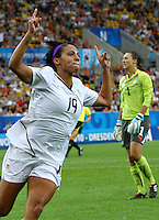 USA's Sydney Leroux celebrates after scoring 5:0 against goalkeeper Nathalie Schwery of Switzerland (background) during the FIFA U20 Women's World Cup at the Rudolf Harbig Stadium in Dresden, Germany on July 17th, 2010.