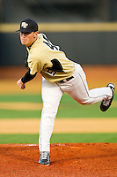Starting pitcher Brian Holmes #45 of the Wake Forest Demon Deacons in action against the Northwestern Wildcats at Gene Hooks Field on February 26, 2011 in Winston-Salem, North Carolina.  Photo by Brian Westerholt / Four Seam Images