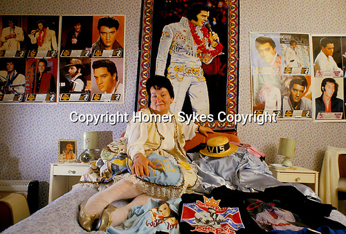 'ELVIS FANS', VALERIE CONSTABLE IN HER BEDROOM WHERE THE WALLS ARE COVERED WITH POSTERS OF HER IDOL, SOUTH LONDON.