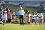 Last years winner Mark Wiebe celebrates his putt on the 13th  green during day one of The Senior Open Golf Tournament at The Royal Porthcawl Golf Club in South Wales this afternoon.