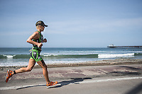 Heather Jackson runs down the stand during the Accenture Ironman California 70.3 in Oceanside, CA on March 29, 2014.