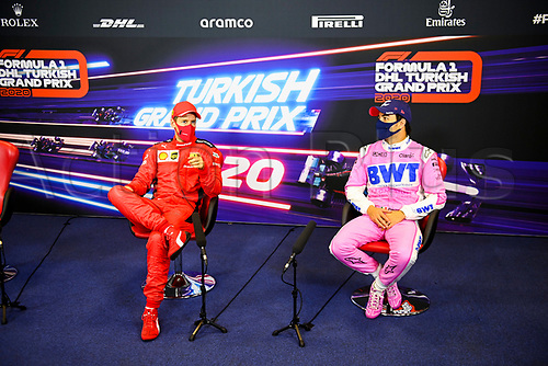 15th November 2020; Istanbul Park, Istanbul, Turkey; FIA Formula One World Championship 2020, Grand Prix of Turkey, Race Day; 3rd placed  Sebastian Vettel GER, Scuderia Ferrari Mission Winnow with 2nd placed Sergio Perez MEX, BWT Racing Point F1 Team