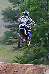 Motocross racer going over a jump