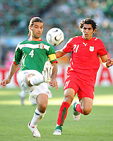 Mexican captain Rafa Marquez hooks the ball away from Mehrzad Madanchi of Iran. Mexico defeated Iran 3-1 during a World Cup Group D match at Franken-Stadion, Nurenberg, Germany on Sunday June 11, 2006.