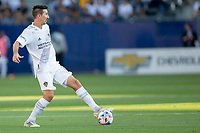 CARSON, CA - JUNE 19: Sacha Kljestan #16 of the Los Angeles Galaxy passes off the ball during a game between Seattle Sounders FC and Los Angeles Galaxy at Dignity Health Sports Park on June 19, 2021 in Carson, California.