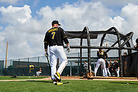 Pittsburgh Pirates Garth Brooks (7) watches Jacob Stallings (58) in the batting cage during the teams first Spring Training practice on February 18, 2019 at Pirate City in Bradenton, Florida.  (Mike Janes/Four Seam Images)