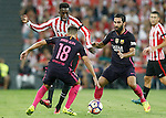 Athletic de Bilbao's Inaki Williams (c) and FC Barcelona's Jordi Alba (l) and Arda Turan during La Liga match. August 28,2016. (ALTERPHOTOS/Acero)