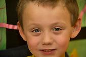 MR / Schenectady, NY. Zoller Elementary School (urban public school). Kindergarten inclusion classroom. Facial closeup of student (boy, 5) in classroom. MR: Bur12. ID: AM-gKw. © Ellen B. Senisi.