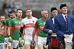 Kilmurry Ibrickane captain Thomas O Connor leads out his team behind the band ahead of their senior football final replay against Cratloe at Cusack park. Photograph by John Kelly.