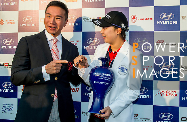 Tenniel Chu Vice Chairman of Mission Hills Group (L) poses with Hyo Joo Kim of Korea during the Hyundai China Ladies Open 2014 at World Cup Course in Mission Hills Shenzhen on December 14<br /> 2014, in Shenzhen, China. Photo by Li Man Yuen / Power Sport Images