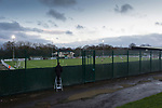 A Bradford Park Avenue fan outside Horsfall Stadium watching on a step ladder, as his team lose 1-2 to Telford United in the National League North, 21st November 2020. The match was played behind closed doors, due to the second Coronavirus lockdown.