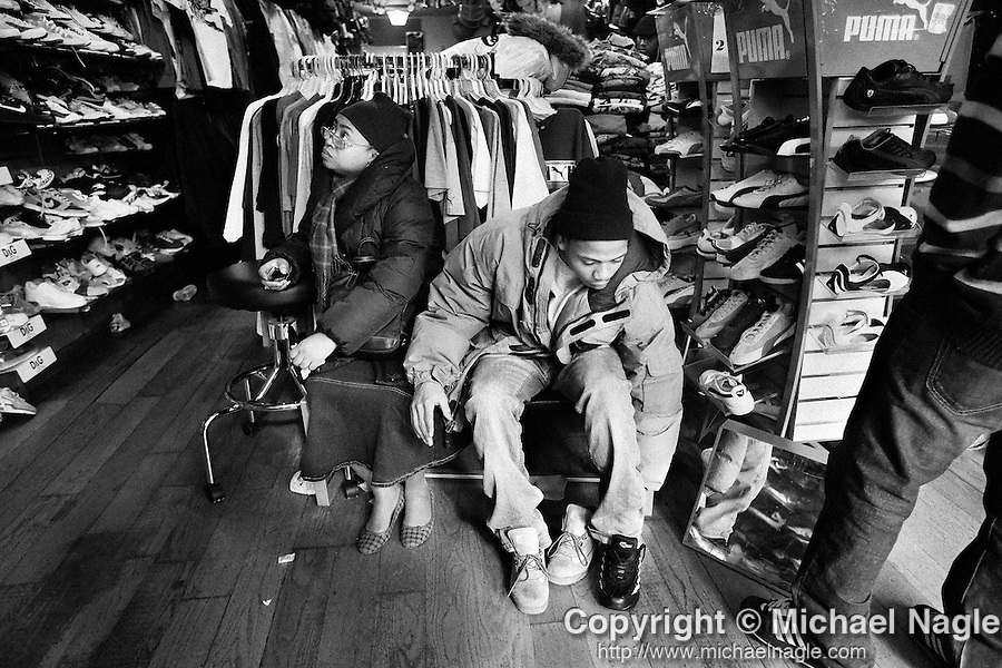 BROOKLYN -- FEBRUARY 14, 2009:  Rapper Aimz shops for new shoes with his mother Tamika (L) on Flatbush Avenue on February 14, 2009 in Brooklyn.  (PHOTOGRAPH BY MICHAEL NAGLE)..