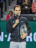 Rotterdam, The Netherlands, 18 Februari, 2018, ABNAMRO World Tennis Tournament, Ahoy, Singles final, Winner of the 45th ABNAMROWTT  Roger Federer (SUI) makes his speech , left  the CEO of the ABNAMRO Bank Kees van Dijkhuizen, right tournament director Richard Krajicek<br /> Photo: www.tennisimages.com/henkkoster