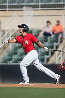 Seby Zavala (21) of the Kannapolis Intimidators follows through on his swing against the Greenville Drive at Intimidators Stadium on June 7, 2016 in Kannapolis, North Carolina.  The Drive defeated the Intimidators 4-1 in game one of a double header.  (Brian Westerholt/Four Seam Images)