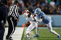 CHAPEL HILL, NC - NOVEMBER 23: DeAndre Hollins #15 of the University of North Carolina forces Yahsin McKee #16 of Mercer University out of bounds during a game between Mercer University and University of North Carolina at Kenan Memorial Stadium on November 23, 2019 in Chapel Hill, North Carolina.