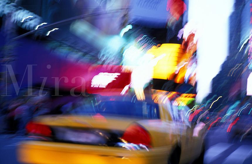 USA, New York, New York City, Taxi blurring down street