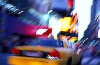 USA, New York, New York City, Taxi blurring down street