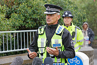 Pictured: Superintendent Andy Moore of British Transport Police during a press conference near the scene of the train fire in Llangennech, Wales, UK. Thursday 27 August 2020<br /> Re: A freight train carrying diesel has derailed and burst into flames in Llangennech, near Llanelli, Wales, UK.<br /> People living nearby in Carmarthenshire, were evacuated but have since returned to their homes.<br /> Police declared a major incident, put a cordon in place and closed roads.<br /> The two workers who were on board the train have been accounted for and no injuries have been reported according  to the British Transport Police.