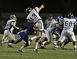 Quarterback is hit as he throws the ball. Damien High School vs. Bishop Amat High School.