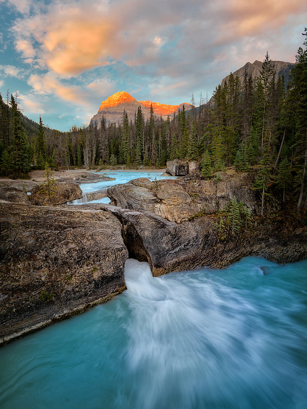 Kicking Horse River and Natural Bridge Falls with sunset in British Columbia's Canadian Rockies and Yoho National Park.
