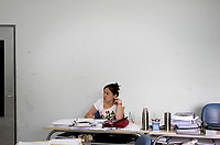 CHINA. Beijing. A student during class at Aoji, an organisation which assists Chinese students in language training and placing them in overseas universities throughout the world. 2010