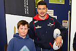 NELSON, NEW ZEALAND - July 26: David Havili with a fan during the Tasman Makos Family Fun Day at TRU Players Room, Trafalgar Park July 26, 2015 in Nelson, New Zealand. (Photo by Marc Palmano/Shuttersport Limited)