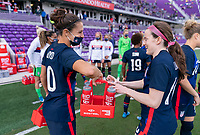 ORLANDO, FL - FEBRUARY 21: Carli Lloyd #10  of the USWNT brings water to Rose Lavelle #16 before a game between Brazil and USWNT at Exploria Stadium on February 21, 2021 in Orlando, Florida.