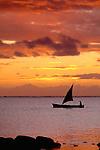 Small sailboat at sunset, Mauritius