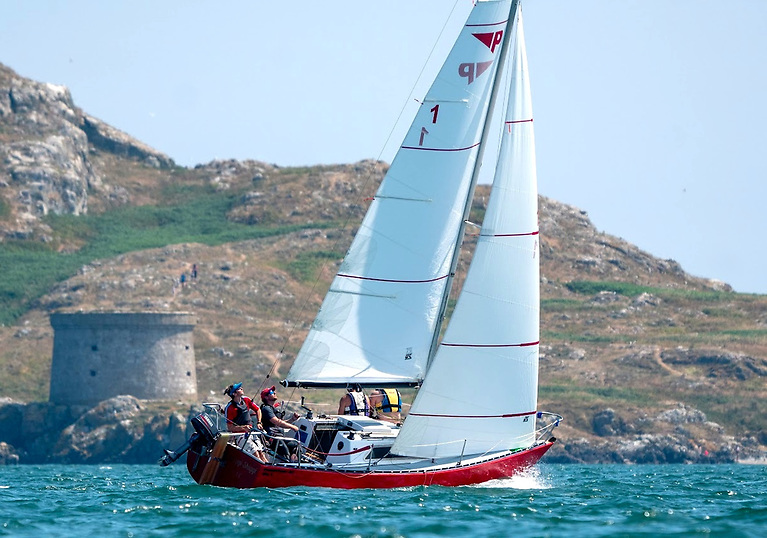 Winner trim. Siggi Siggi looking every inch a champion as she races through Howth Sound past the Martello Tower on Ireland's Eye. Photo: Annraoi Blaney