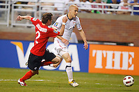 7 June 2011: Canada midfielder Nikolas Ledgerwood (2) and USA Men's National Team midfielder Michael Bradley (4) go for the ball during the CONCACAF soccer match between USA and Canada at Ford Field Detroit, Michigan. USA won 2-0.
