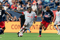FOXBOROUGH, MA - JULY 7: Ayo Akinola #20 of Toronto FC on the attack as Andrew Farrell #2 of New England Revolution closes during a game between Toronto FC and New England Revolution at Gillette Stadium on July 7, 2021 in Foxborough, Massachusetts.