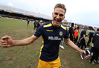 Mickey Demetriou of Newport County celebrates during a lap of honour after the final whistle of the Sky Bet League Two match between Newport County and Notts County at Rodney Parade, Newport, Wales, UK. Saturday 06 May 2017