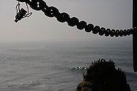 Seabirds sit on top of the rock near the intersection of Sunset Cliffs Blvd and Froude Street where a peace sign stood for about eighteen months until it dissppeared mysteriously over the weekend on January 5 & 6, 2008.  A note appealing for the return of hte sign had been attached to the chain in the foreground but it too had dissappered by Friday, January 11, 2008.