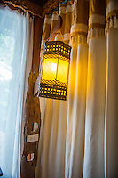 Thailand, Koh Phangan Island. Santhiya Resort. Light in the room.
