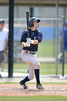 Shortstop Tyler Wade (2) of the New York Yankees organization hits a home run during a minor league spring training game against the Toronto Blue Jays on March 16, 2014 at the Englebert Minor League Complex in Dunedin, Florida.  (Mike Janes/Four Seam Images)