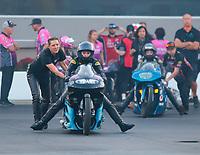 Oct 11, 2019; Concord, NC, USA; NHRA pro stock motorcycle rider Jianna Salinas is pushed by Karen Stoffer during qualifying for the Carolina Nationals at zMax Dragway. Mandatory Credit: Mark J. Rebilas-USA TODAY Sports