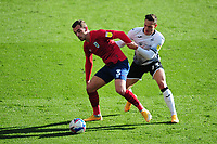 Harry Toffolo of Huddersfield Town vies for possession with Connor Roberts of Swansea City during the Sky Bet Championship match between Swansea City and Huddersfield Town at the Liberty Stadium in Swansea, Wales, UK. Saturday 17 October 2020