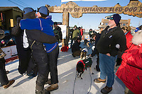 Rookie Tom Lesatz gives a big hug to his kennel partner and girl freind Jessica Hendricks a the finish line as his father looks on