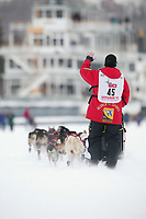 Dog Musher Aily Zirkle leaves the shoot for the 1000 mile 2003 Iditarod sled dog race from Fairbanks to Nome, Alaska . Lack of snow along the normal trail route further south forced the relocation of the restart on the Chena River in Fairbanks.