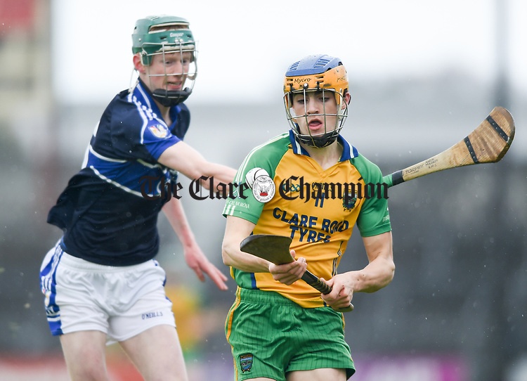 Aidan Mc Carthy of Inagh-Kilnamona in action against Aaron Moloney of Kilmaley during their Minor A county final at Cusack Park. Photograph by John Kelly.