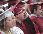 NAUGATUCK, CT - 20 June 2004 - 062204BZ11- Ben Masliuk yells to a fellow graduate during commencement excercises at Naugatuck High School Tuesday night.<br />Jamison C. Bazinet Photo
