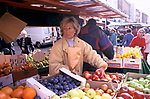 Street market London. Portobello Road.  Saturday traditional fruit market stall. Woman market stall holder. 1990s UK 1999