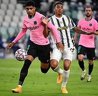 Football Soccer: UEFA Champions League -Group Stage-  Group G - Juventus vs FC Barcellona, Allianz Stadium. Turin, Italy, October 28, 2020.<br /> Barcellona's Ronald Araujo (l) in action with Juventus' Daniloc (r) during the Uefa Champions League football soccer match between Juventus and Barcellona at Allianz Stadium in Turin, October 28, 2020.<br /> UPDATE IMAGES PRESS/Isabella Bonotto