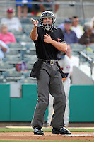 Home umpire Mario Seneca makes a call during a game between the Palm Beach Cardinals and Fort Myers Miracle at Roger Dean Stadium on May 2, 2012 in Jupiter, Florida.  Fort Myers defeated Palm Beach 2-1.  (Mike Janes/Four Seam Images)